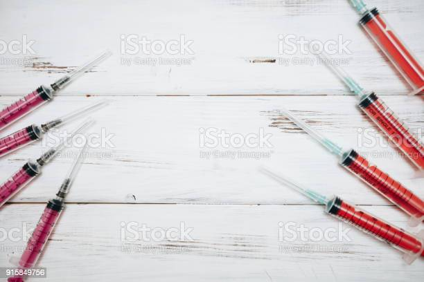 White background with syringes picture id915849756?b=1&k=6&m=915849756&s=612x612&h=xpxnkdinbi6akjwis1c4qqmwo2hv16qkonfz7enhcxa=