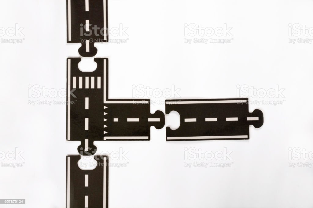 White background with two puzzle  pieces of a highway with empty copy space stock photo