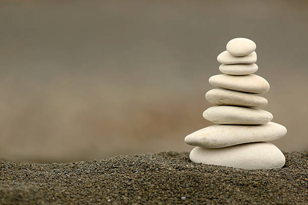 white balance zen stones - stability stock photos and pictures