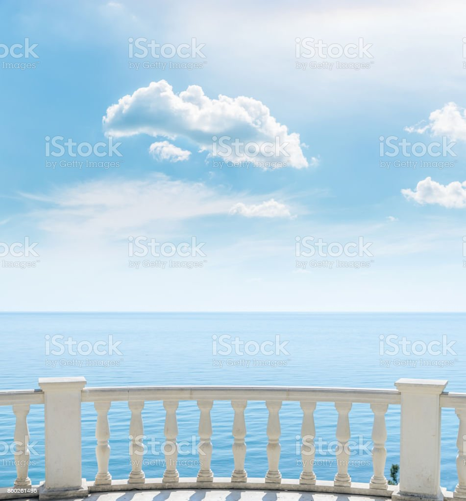 white balcony over sea and clouds in blue sky stock photo