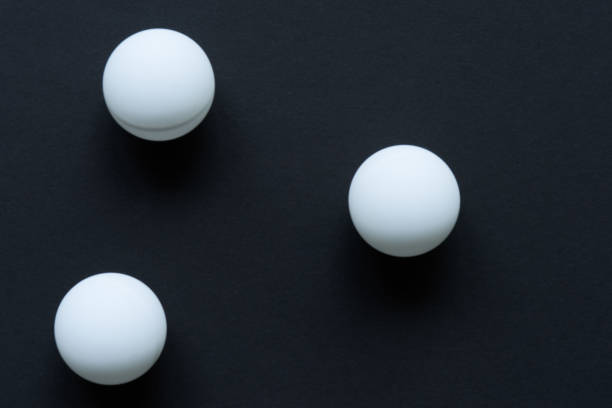 white ball on black background - cue ball stock pictures, royalty-free photos & images