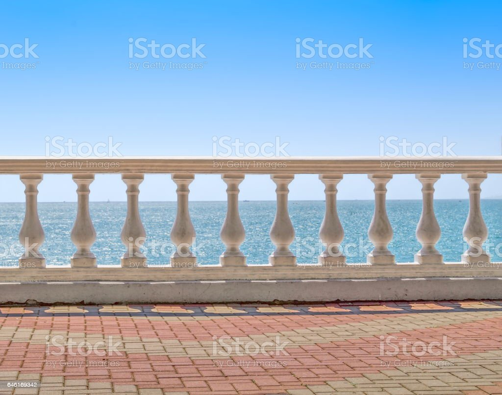 White baluster overlooking the sea stock photo
