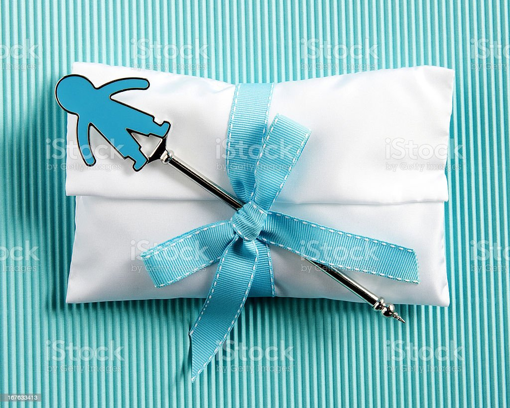 white baptism sugared almonds for boy  on striped blue background royalty-free stock photo