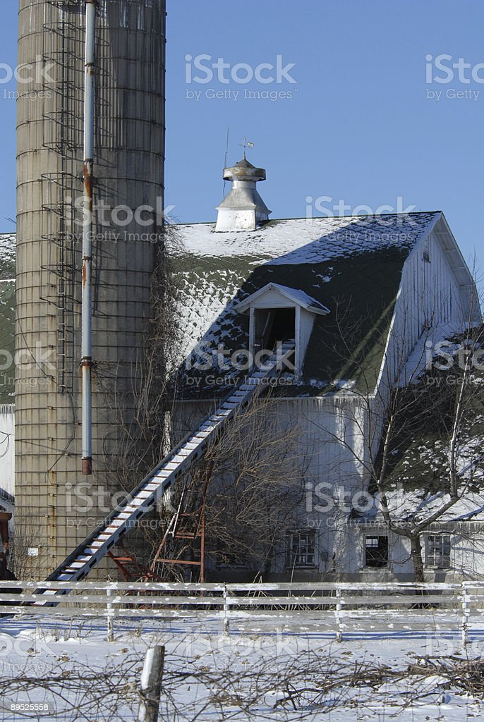 White Barn and Silo in the Snow royalty-free stock photo