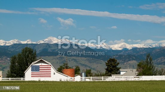 White barn with painted American Flag in Colorado.