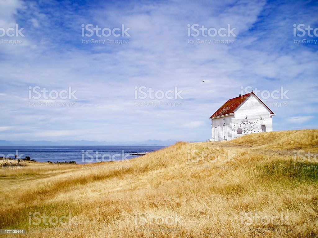 White Barn With Red Roof in Field stock photo