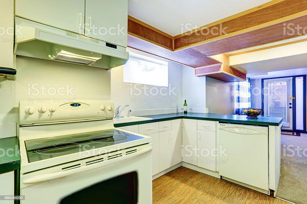White basement kitchen room with green counter tops Стоковые фото Стоковая фотография