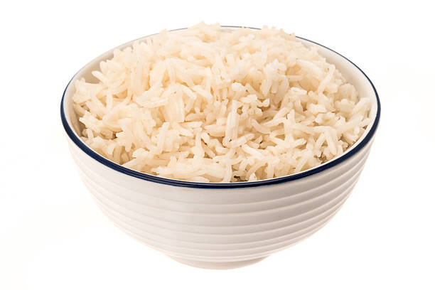 White Basmati rice in a bowl White Basmati rice in a bowl - studio shot with a white background basmati rice stock pictures, royalty-free photos & images