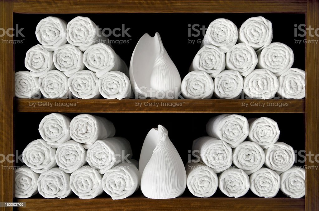 White bath towels with sea shells royalty-free stock photo