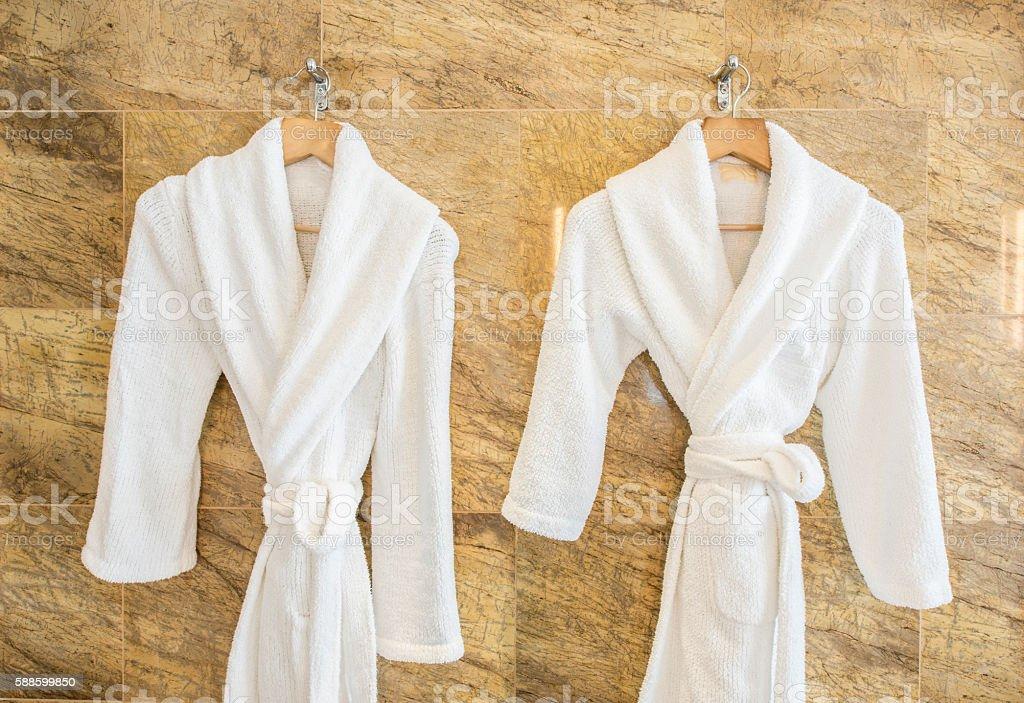 White bathrobe on hanger stock photo