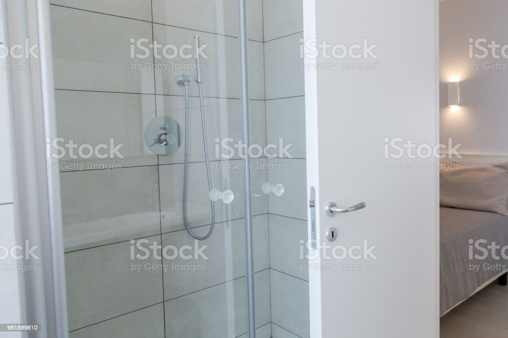 White bathroom. Modern shower with glass door stock photo