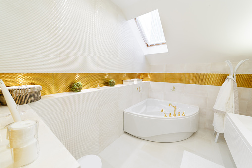 618327092 istock photo White bathroom with gold trim. Corner bathroom, chic mirror with washbasin. 1224398511