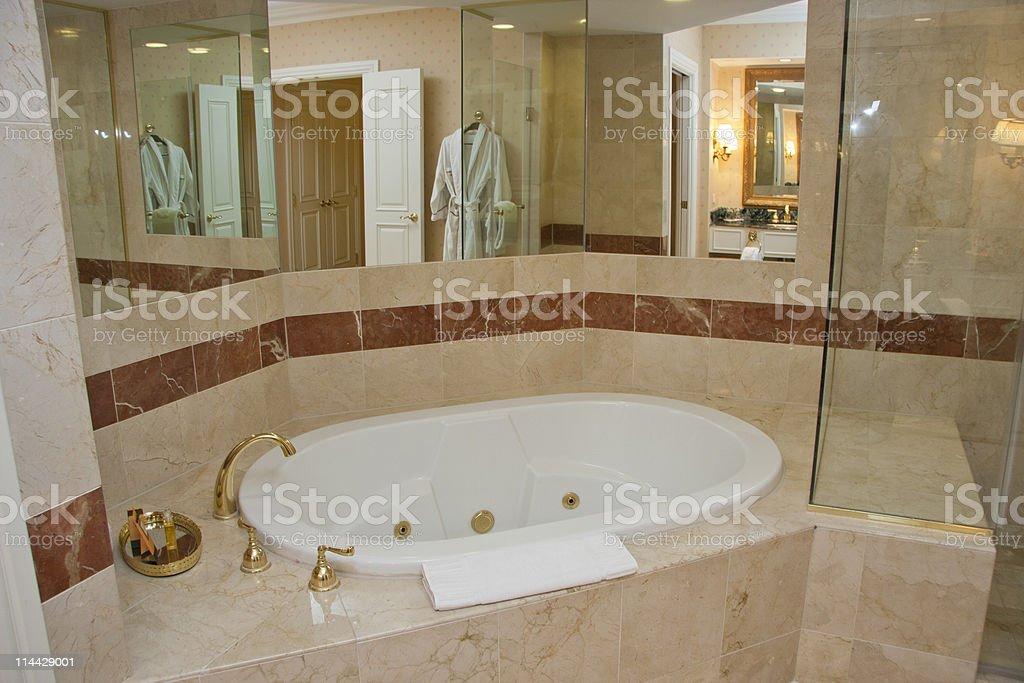 White bathtub and brass taps royalty-free stock photo