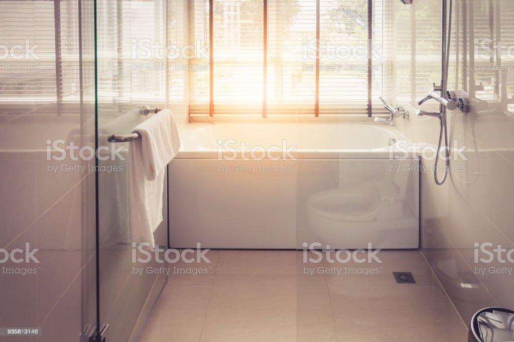 White Bathtub In Cleadn Bathroom With Big Window And Blindshade  Royalty Free Stock Photo