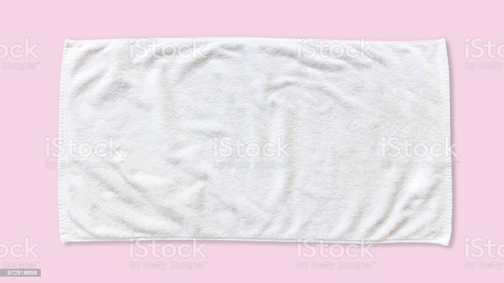 White beach towel mock up isolated with clipping path on pink...