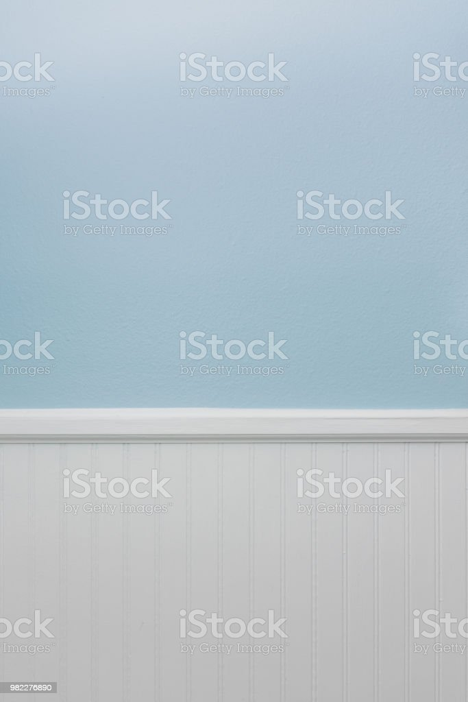 White bead board or wainscot, light blue wall paint stock photo