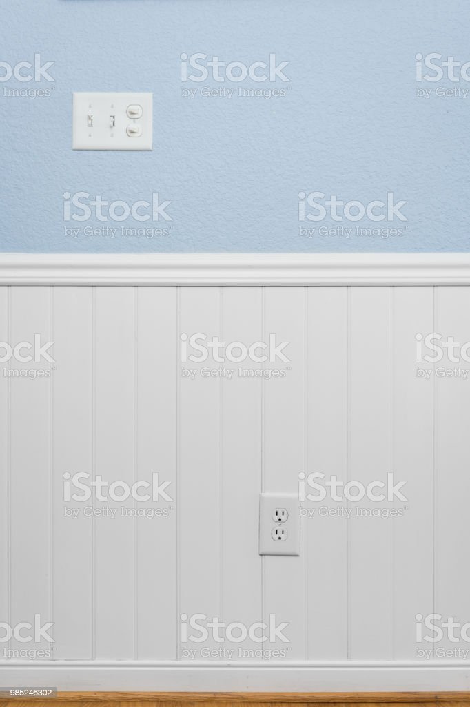 White beadboard or wainscoting with light blue wall paint stock photo