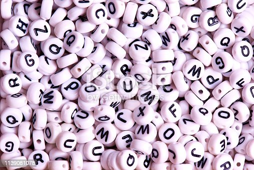 istock White beads with black English letters close-up. 1139081078