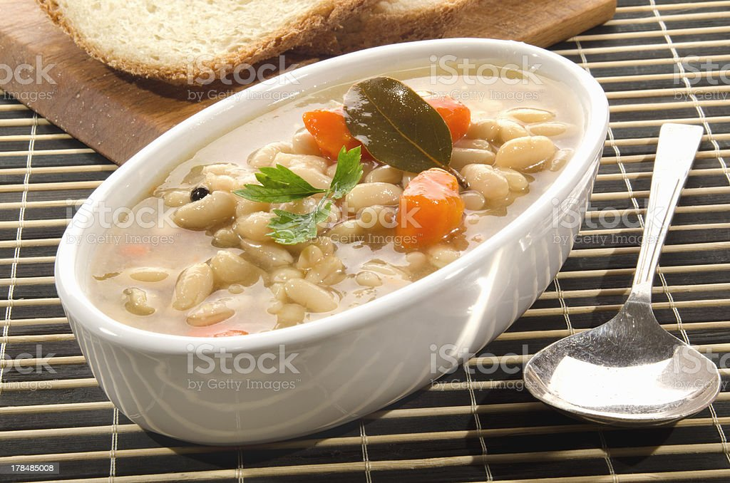 white bean soup with carrots stock photo