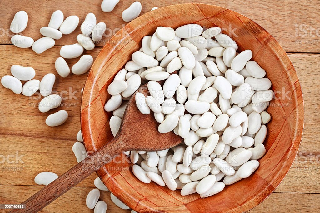 White beans on a wooden board stock photo