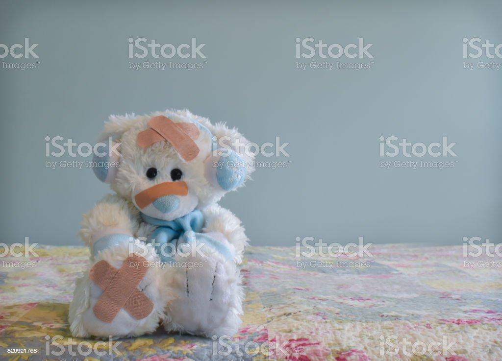 White Bear With Bandages stock photo