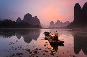 Cormorant fisherman getting ready for night fishing on the Li River, near Xingping Town, Guangxi province, China.