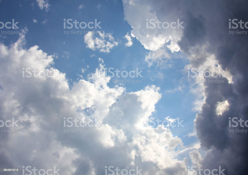White beautiful fluffy curly clouds on blue sky, background of white clouds and blue sky, place for text royalty-free stock photo