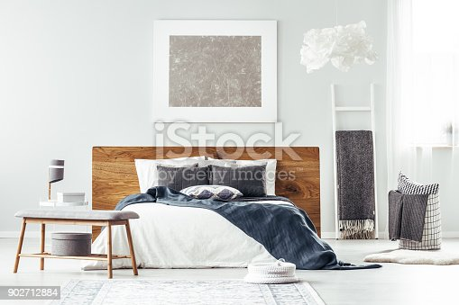 istock White bed in bedroom interior 902712884