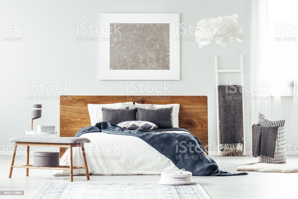 White bed in bedroom interior stock photo