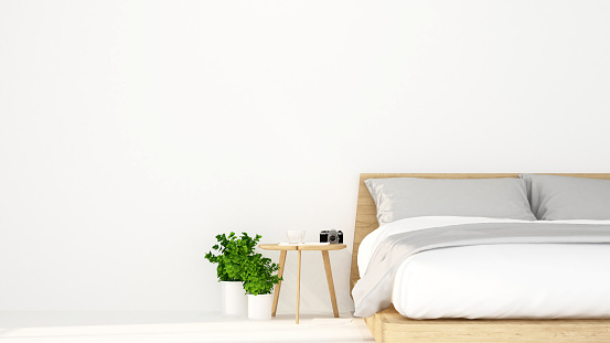 istock white bed room in hotel or apartment for artwork - Interior design - 3D Rendering 867968842