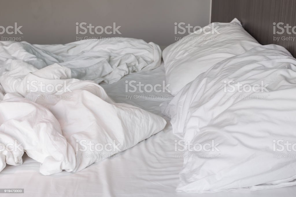 White Bedding Sheets And Pillow, Messy Bed Concept Royalty Free Stock Photo