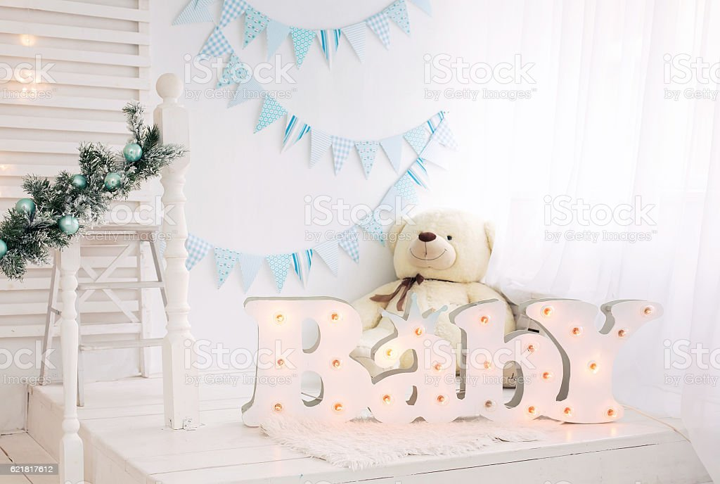 White bedroom for child with blue and white decorations stock photo
