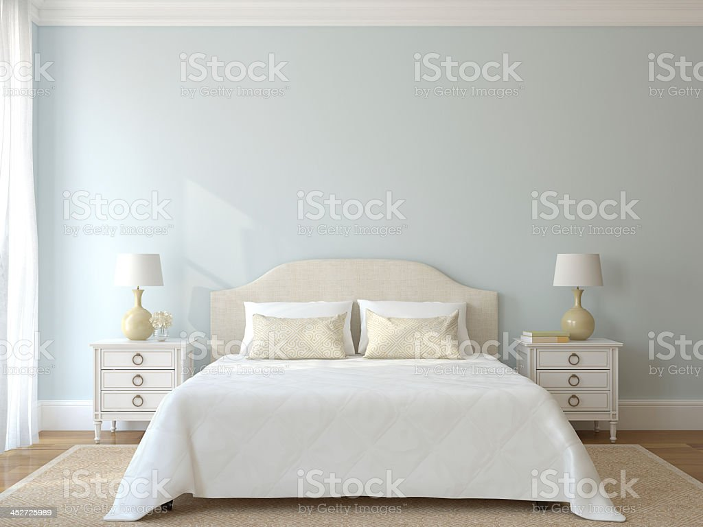 White bedroom furniture with a blue wall stock photo
