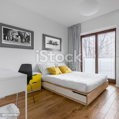 istock White bedroom with bed and desk 822101164