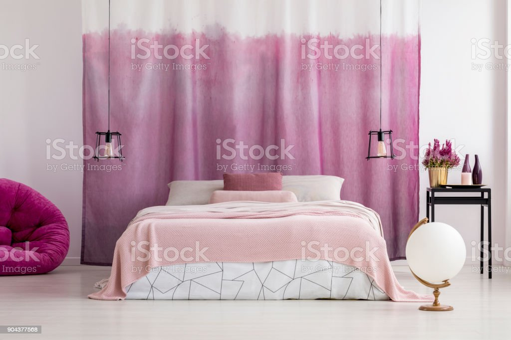 White bedroom with pink accents stock photo