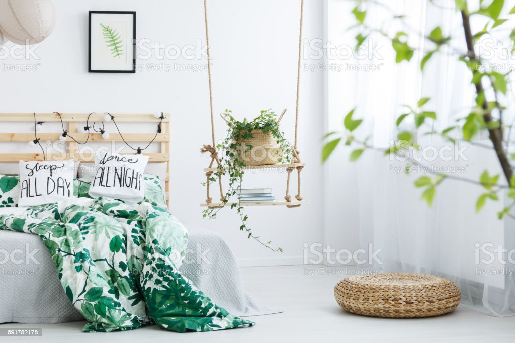 White bedroom with rattan pouf stock photo
