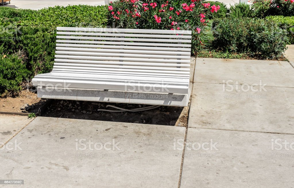 White bench in the street. royalty-free stock photo