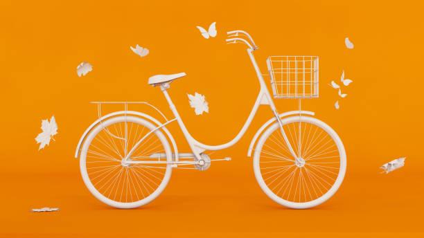 White Bicycle on Orange Background stock photo