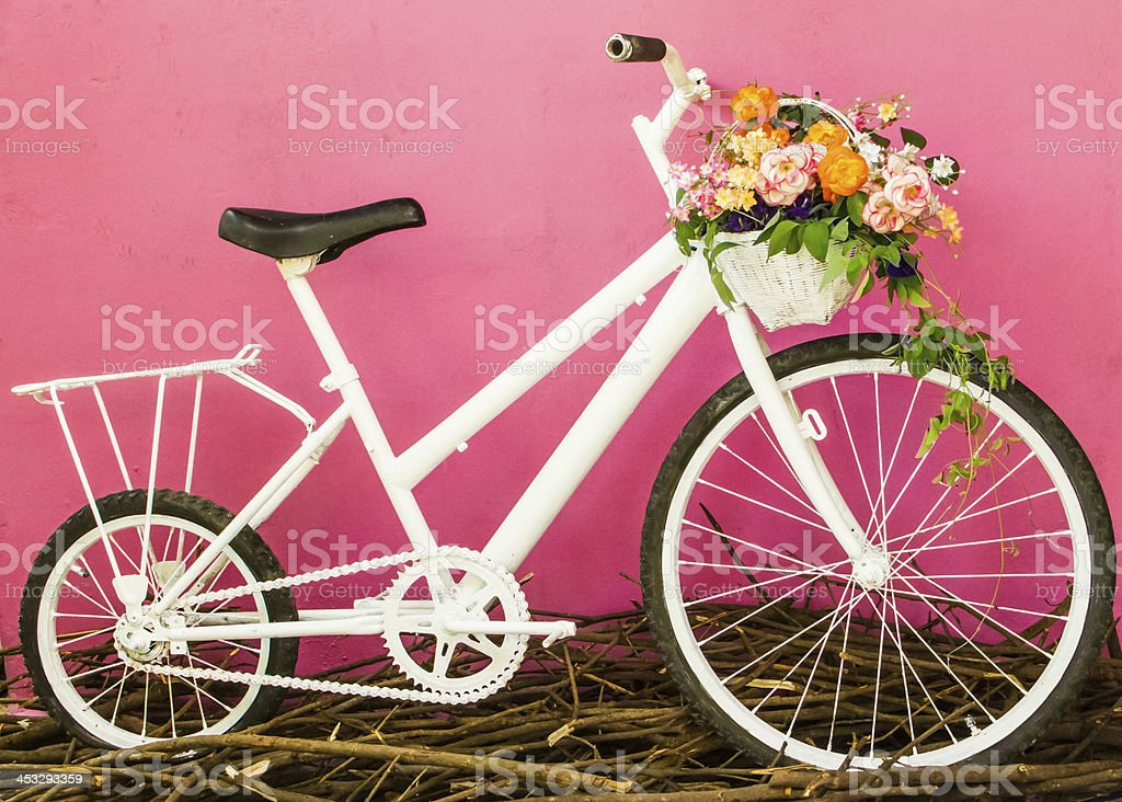 White bicycle on pink wall stock photo