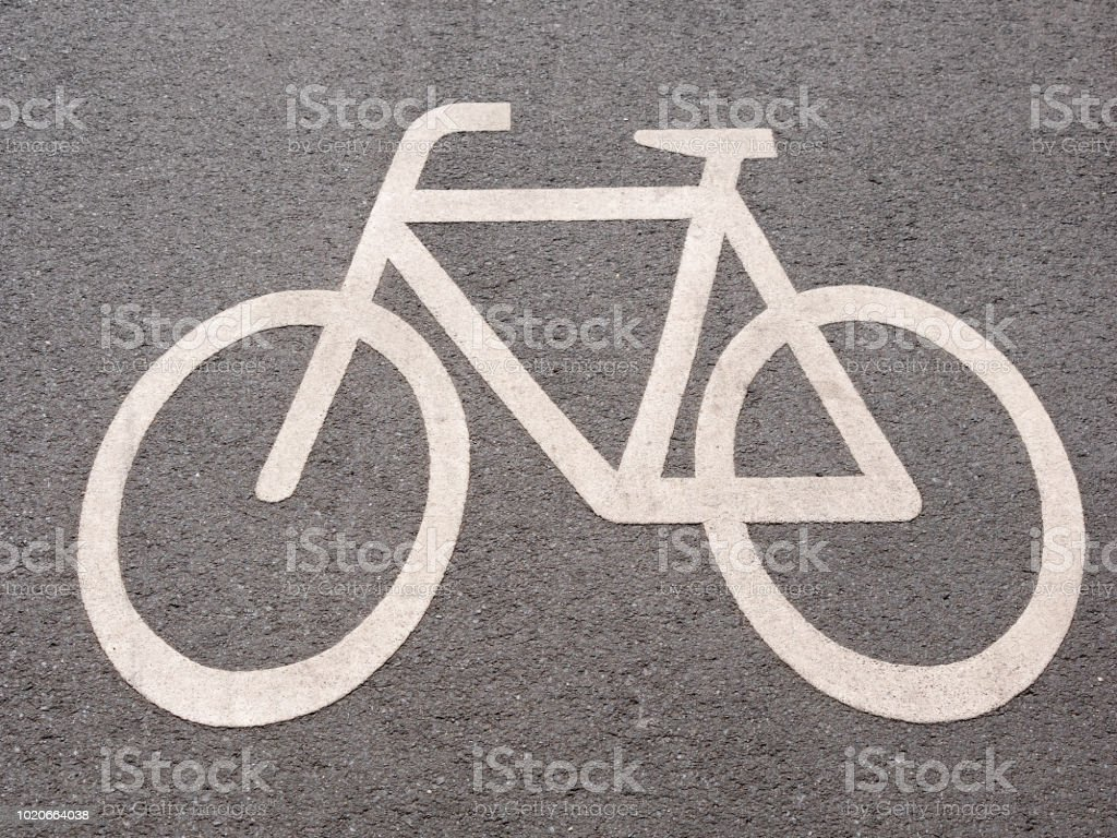 White Bicycle Sign On Asphalt Road In Berlin, Germany stock photo
