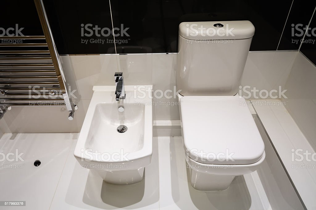 White Bidet and Toilet stock photo