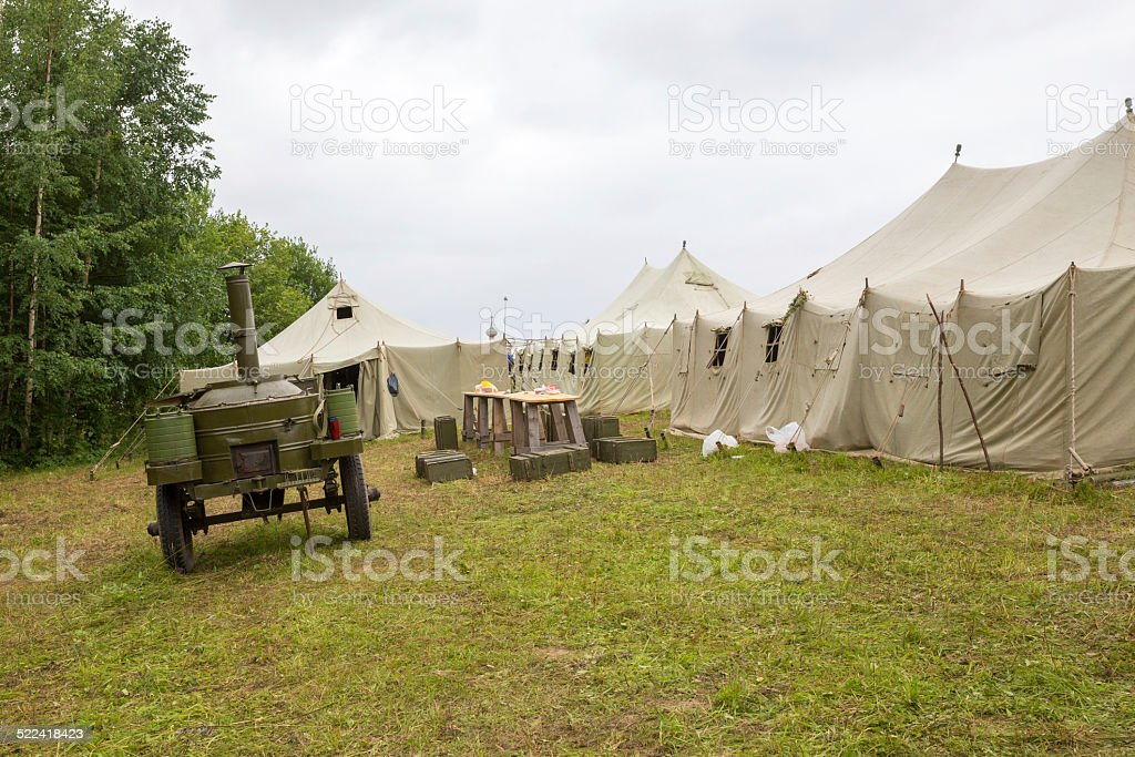 white big army tent and field kitchen stock photo