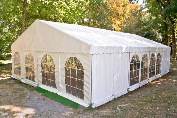 White big tent in forest White big tent in forest entertainment tent stock pictures, royalty-free photos & images