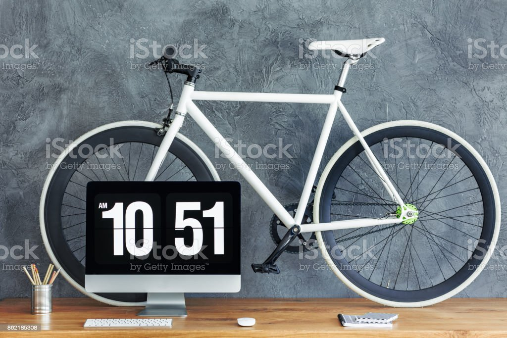 White bike on wooden table stock photo