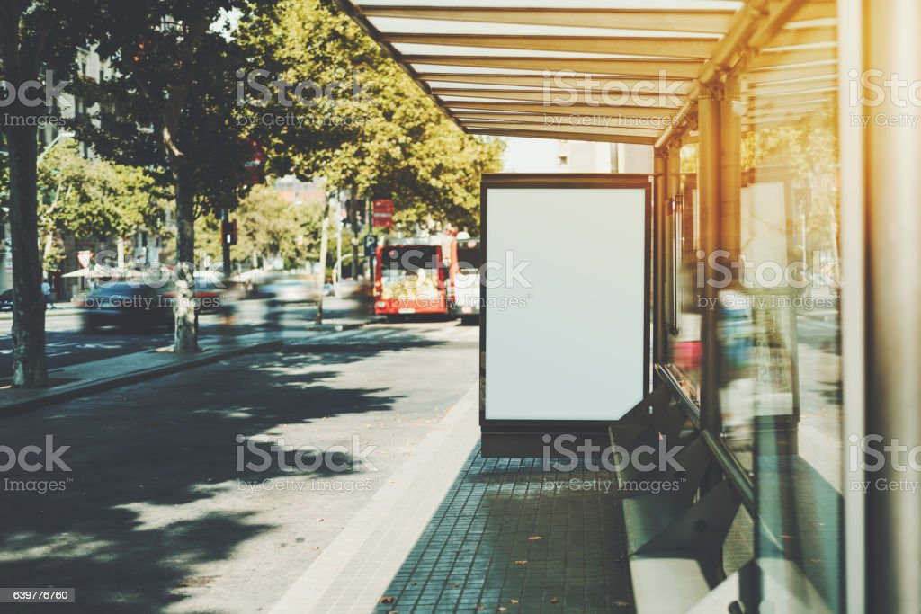 White billboard on city bus stop stock photo