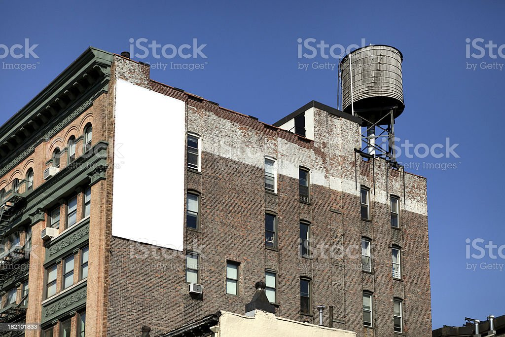 White Billboard on the brick wall. stock photo