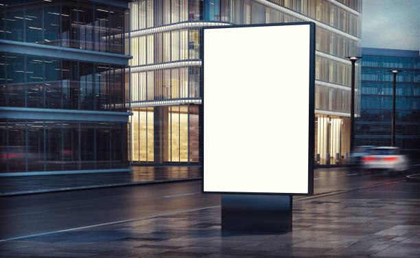 weißes plakat auf der straße - bibliothekschilder stock-fotos und bilder