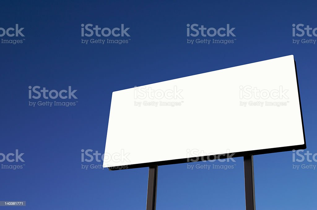 White Billboard with blue sky sun on lower right royalty-free stock photo