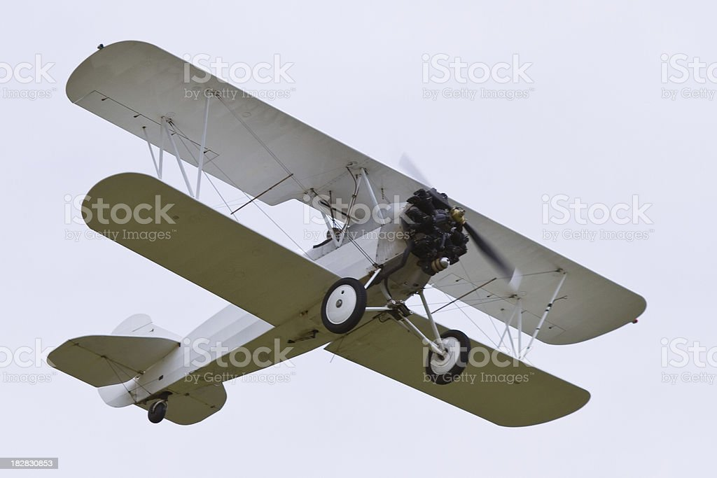 White Biplane Flying 2 stock photo