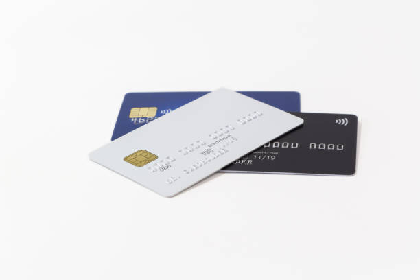 White, black and blue credit cards on white background stock photo